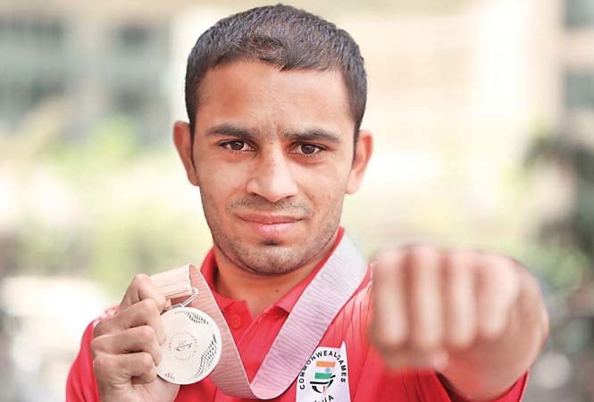 Amit Panghal with his Commonwealth Games silver medal
