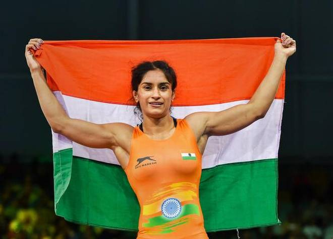 Vinesh Phogat celebrates after winning the gold medal at the Gold Coast 2018 Commonwealth Games