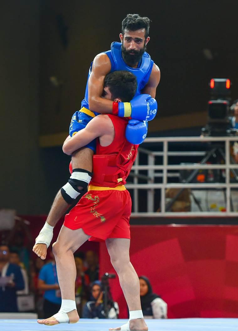 Surya Bhanu Pratap Singh with opponent Erfan wushu india martial-arts-kreedon