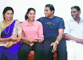 anju bobby george family