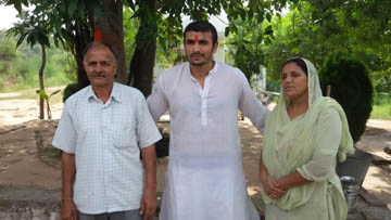 Ajay with his parents