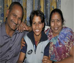 Poonam Yadav with her parents