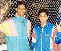 KM Beenamol with her brother