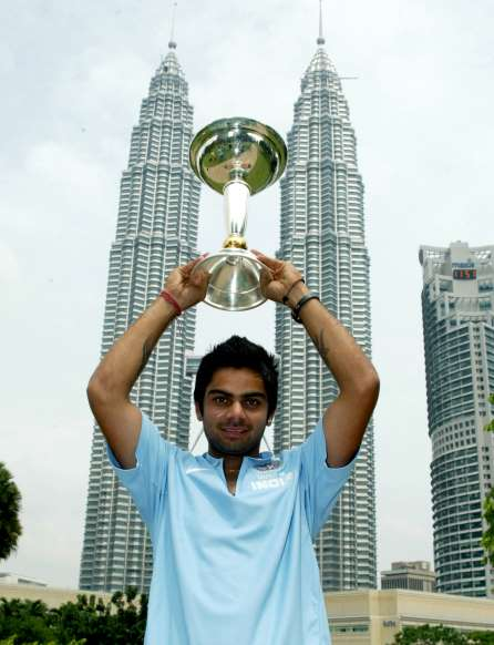 Virat with the U-19 World Cup trophy in Malaysia Kreedon (Virat Kohli pics)