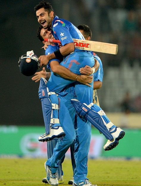 Yuvraj Singh lifts Virat Kohli after 2014 T-20 World Cup Semi-Finals win against SA Kreedon (Virat Kohli pics)