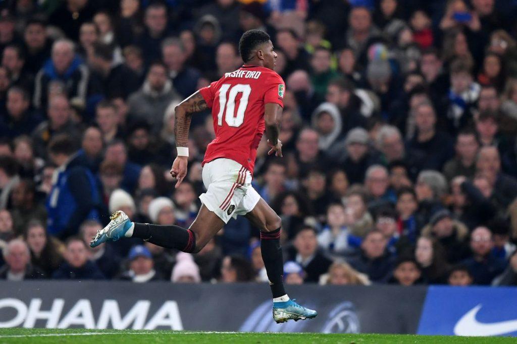 Rashford celebrates a brace against Chelsea at Stamford Bridge