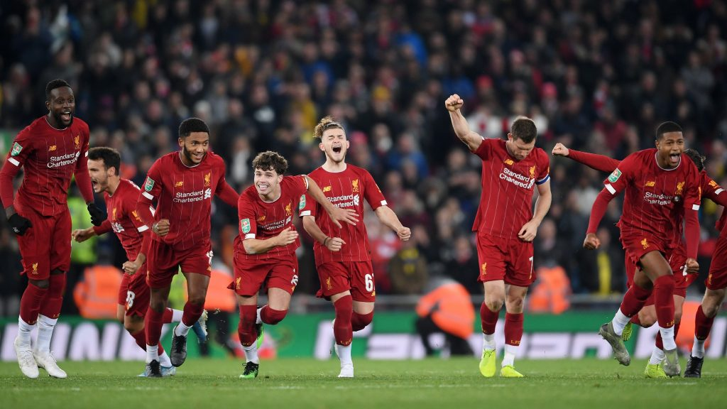 Liverpool celebrates penalty shootout win against Arsenal in the Carabao Cup